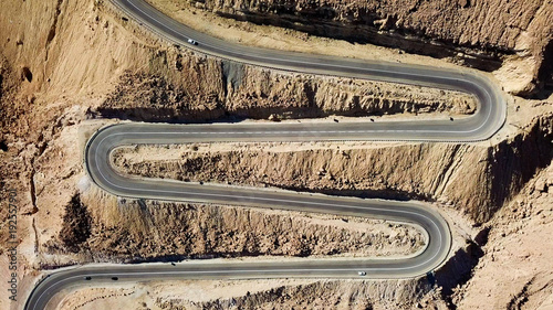 Papiers peints Beige Desert road - Aerial image of traffic going up and down a serpentine mountain road