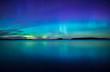 Quadro Northern lights dancing over calm lake. Farnebofjarden national park in Sweden