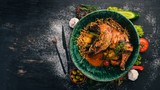 Grilled chicken cooked in a hoster. Meat. Top view. On a black wooden background. Copy space. - 192569301