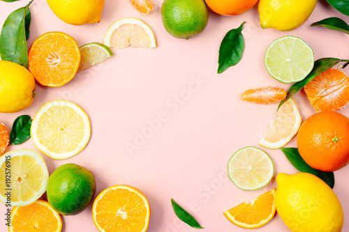 Citrus fruits frame on pink background - 192576915