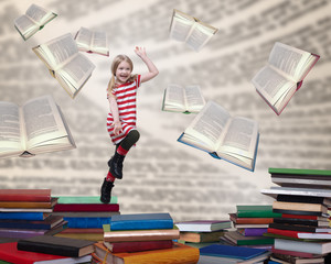 Happy child jumping out of the books
