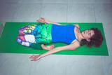 young woman practice yoga lying in reclining hero position indoor shot - 192581109