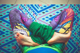 woman legs in colorful leggings in lotus pose from above view indoor - 192581159