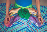 woman legs in colorful leggings in lotus pose from above view indoor - 192582353