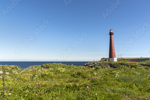 red lighthouse in Andenes at the beginning of National Tourist Route Andøya in Lofoten in Norway