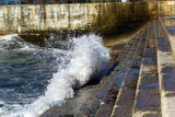 water drowns the waterfront. big water spray wave - 192597723