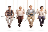 Cheerful seniors sitting on wooden swings and looking at the camera - 192598326