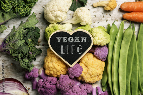 raw vegetables and text vegan life - 192604378