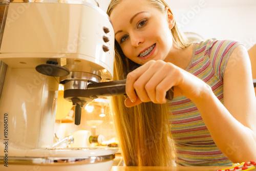 Sticker Woman in kitchen making coffee from machine