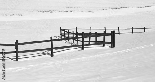 long fence with white fresh snow
