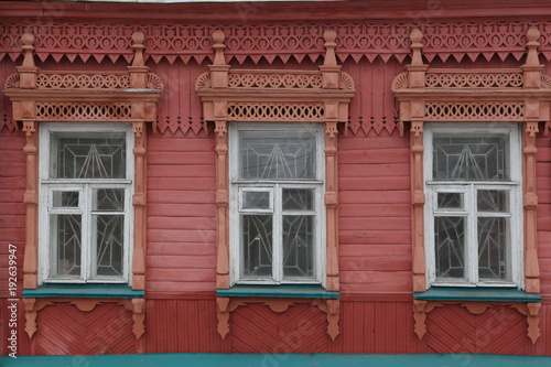 Wooden carved frames and windows on wooden house in Ulyanovsk city (Russia)