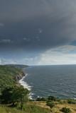 Heavy, rainy dark clouds on the coast