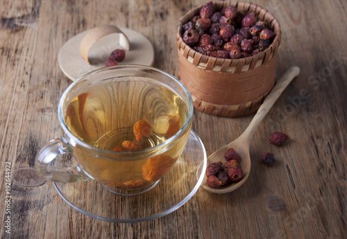 Cup tea of rosehip and dried rosehip in a birch box