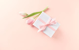 Gift Box with Pink Tulip on Powder Pink Paper Background - 192660729