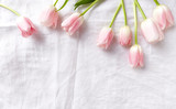 Pastel Pink Tulips on White Linen Cloth - 192660788