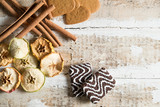 cookie hearts and chocolate with cinnamon sticks and slices of dried apples with text space on wooden background - 192662144