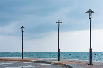 Three lamp pole by the seaside at HuaThanon view point on Koh Samui Thailand