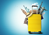 Yellow travel bag with world landmark, holiday and tourism - 192685352