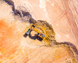 Aerial view of a working excavator in the open cast mine. Heavy industry and machinery. Industrial background on mining theme.  - 192688972