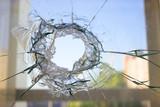broken glass window reflecting blue sky - 192699967
