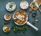 Healthy vegetarian one pot couscous  with vegetables and feta cheese in white pan, top view. Tasty easy homemade dinner meal . - 192702525