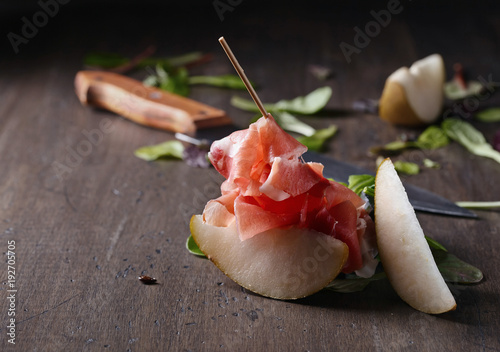 Wall mural Prosciutto with pear and spinach .