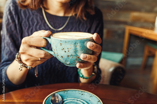 Female Hands Holding Cup Of Coffee © EdNurg