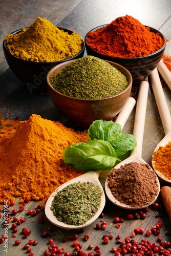 Foto op Canvas Hot chili peppers Variety of spices on kitchen table