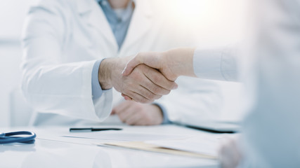 Doctor and patient shaking hands in the office