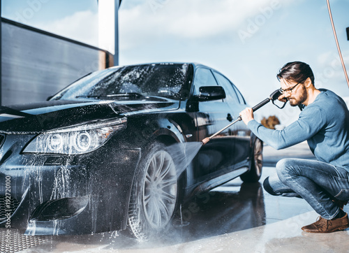 Car washing. Cleaning Car Using High Pressure Water.  - 192720100