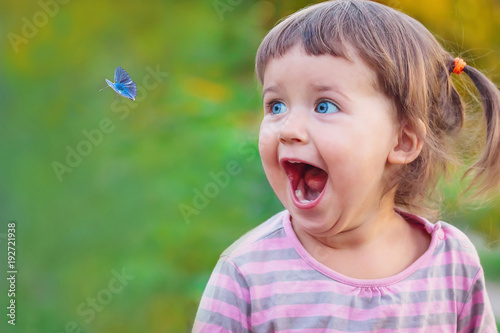 Little girl is surprised and happy