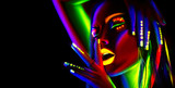 Fashion model woman in neon light. Portrait of beautiful model girl with colorful fluorescent makeup - 192723104