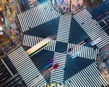 Aerial view of traffic crossing a big intersection in Ginza, Tokyo, Japan at night