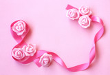 gentle spring background with pink silk ribbon, rose flowers - 192725741