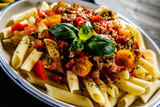 Pasta with meat, tomato sauce and vegetables - 192749504