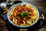 Pasta with meat, tomato sauce and vegetables - 192749505