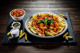 Pasta with meat, tomato sauce and vegetables - 192749511