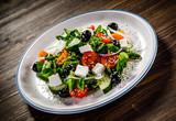 Greek salad on wooden background - 192749524