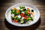 Greek salad on wooden background - 192749526