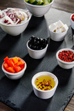Ingredients to Greek salad on wooden background - 192749737