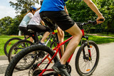Healthy lifestyle - people riding bicycles in city park - 192749911