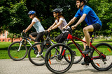 Healthy lifestyle - people riding bicycles in city park - 192749949