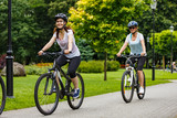 Healthy lifestyle - people riding bicycles in city park - 192749988
