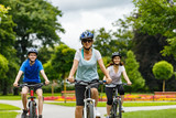 Healthy lifestyle - people riding bicycles in city park - 192749989