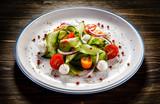 Caprese salad on wooden background - 192750184