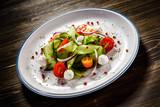 Caprese salad on wooden background - 192750190