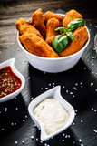 Chicken nuggets with french fries on wooden table - 192750790