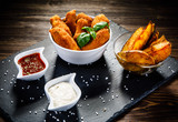Chicken nuggets with french fries on wooden table - 192750791