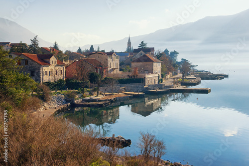 Foto op Canvas Diepbruine Winter view of small Mediterranean town of Dobrota. Montenegro, Bay of Kotor
