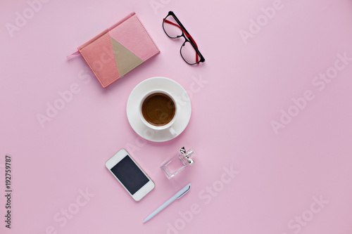 Beauty office desk with cup of cofee, notebook, pen.